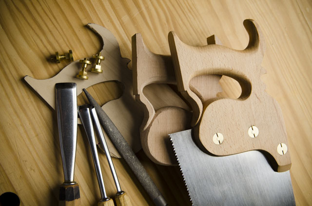 Stages of making a hand saw or panel saw with saw parts, gouges, and a rasp