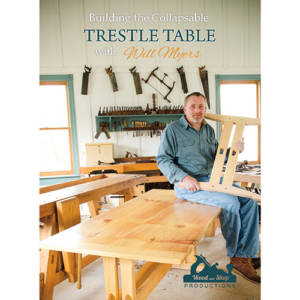 DVD cover for Building a Collapsable Trestle Table with Will Myers sitting on table in woodworking workshop