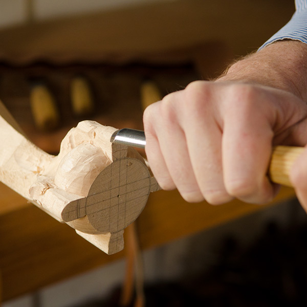 Carving a ball and claw foot with a carving gouge