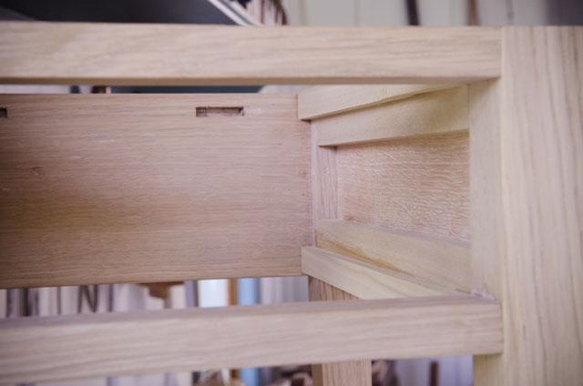 interior of a Shaker end table in figured white oak with ammonia fuming for woodworking plans
