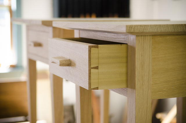 Shaker end table in figured white oak with ammonia fuming for woodworking plans showing exposed dovetail drawer